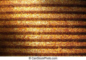 Rusty corrugated metal can surface lit diagonally - Closeup...