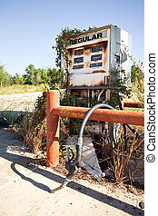 Rusty Decayed Gasoline Dispenser - Plants reclaim a decaying...