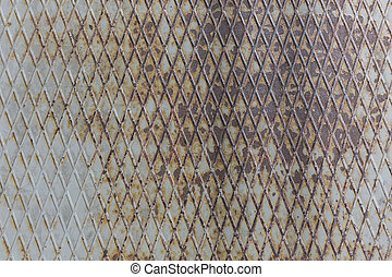 rusty embossed metal surface with old paint abstract pattern texture background