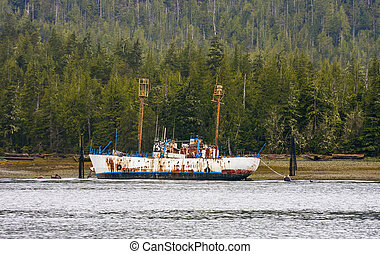 Rusty Freighter Tied up at Shore