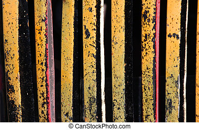 Rust And yellow Peeling Paint Background on grill