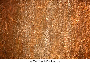Photography shows a rusty metall background with scrachted surface.