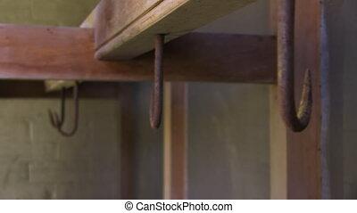 Rusty hooks on wood - A blur to focus shot of rusty hooks.
