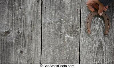 rusty horse shoe hang - Rusty retro horse shoe hanging on...