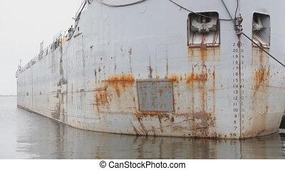 Rusty hull. - Hull of a rusty ship sitting in harbor. Lake...