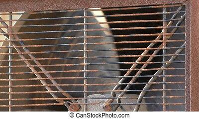 Rusty industrial fan close up