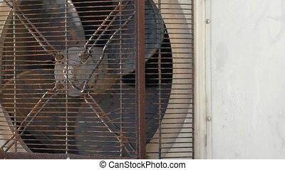 Rusty industrial fan spinning