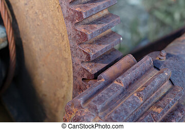 Rusty industrial machine parts gears closeup