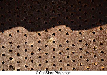 Rusty iron background with holes