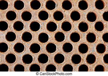 Rusty iron grate - element of industrial heat exchanger -...