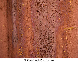 Rusty iron wall, background of an old piece of metal