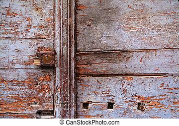 rusty keyhole in a wooden door