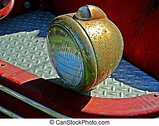 rusty light on old firetruck