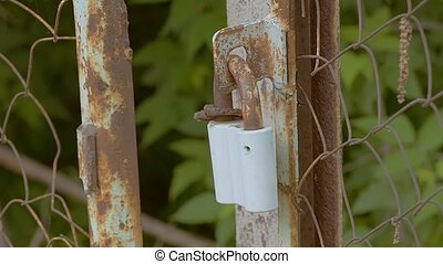 Rusty lock on a chain tied slow motion video - Rusty lock...