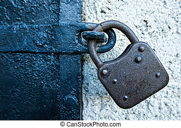 Rusty Lock on an old iron Door