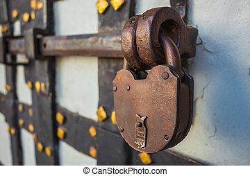 rusty lock on the old door