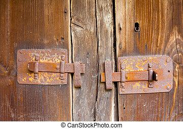 Rusty locks on wood background