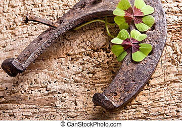 Rusty luck - Horse-shoe and clover, vintage symbols of good...