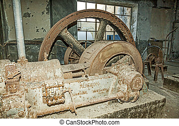 rusty machine in old rotten refinery station