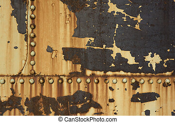 rusty metal background with rivets