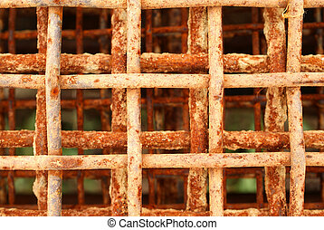 Rusty and old metal grid, suitable for eg. a background. When iron, water and oxygen mix, rust happens.