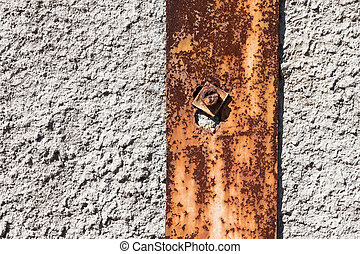 Rusty metal on plaster concrete wall