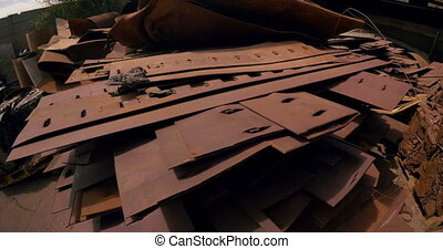 Rusty metal pieces in scrapyard 4k - Rusty metal pieces in...