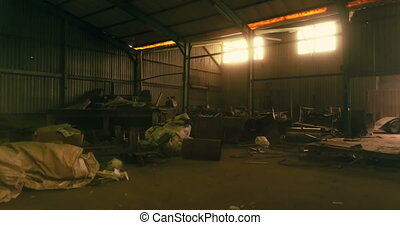 Rusty metal pieces in warehouse 4k - Rusty metal pieces in...