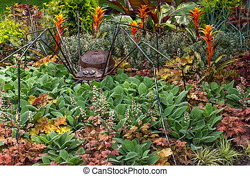 Rusty metal spider decorating a garden