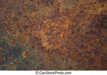 old rusty metal plate with remains of black paint