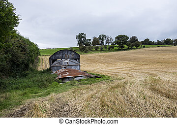 Rusty old barn in field