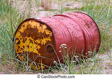 rusty old barrel in a grass