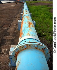 Rusty Old Blue Pipeline - An aging pipeline with signs of...