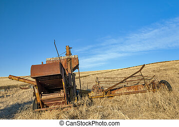 Rusty old combine forgotten by time