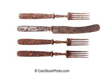 Rusty old fork and knife. Closeup isolated on white background