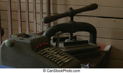 Rusty old metal cash register - A medium shot of a rusty...