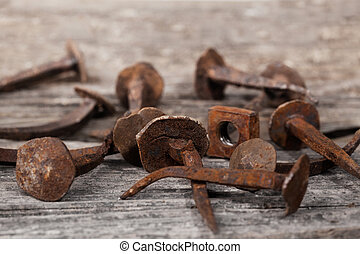 Antique Rusty Nails on a old wood background