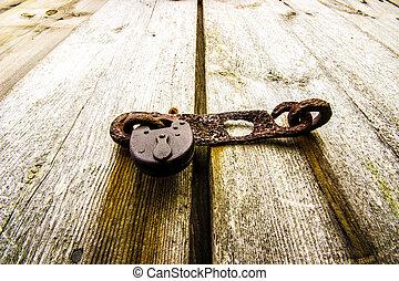 Rusty Old Padlock on Door