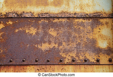 Rusty, painted steel plates held together by small bolts