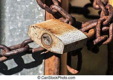 Rusty padlock and metal chain
