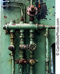 Rusty pipes and valves - Old rusty pipes and valves with...