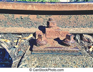 Rusty abandoned rails. Terrible smell rotten old wooden ties with phenol asphalt paint. Environmental burden environmental hazards.