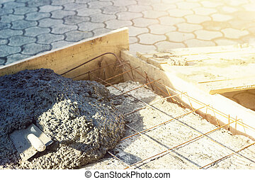 rusty rebar grids with spatula in a concrete floor in...