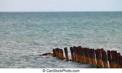 rusty remnants of destroyed pier