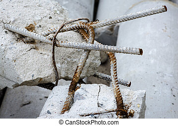 Rusty rods in damaged concrete