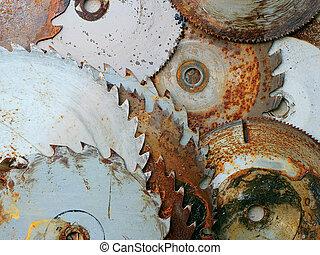 A pile of rusty circular sawblades.