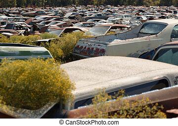 Rusty scrapped cars at a dump