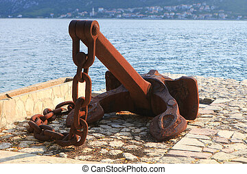 Rusty ship anchor and chain