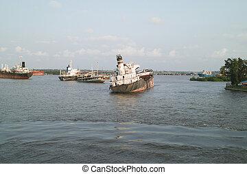 rusty ship in lagos harbour in nigeria africa