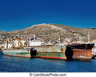 rusty ship in piraeus harbour